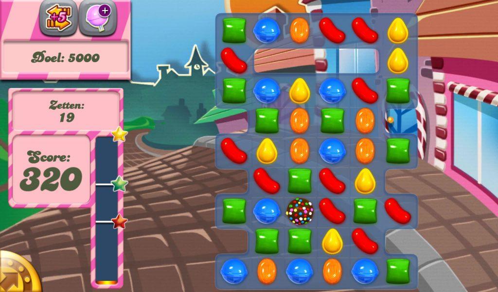 Mängu ekraanil olev kommipurustamissaga, kus on mitu kommi ja tulemus on 320